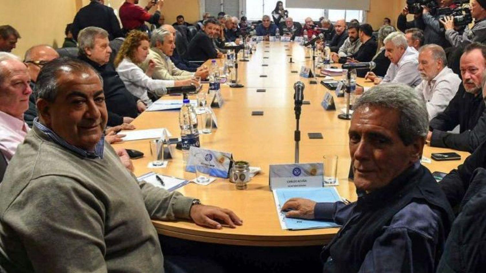 Héctor Daer y Juan Carlos Schmid de la CGT